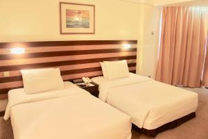 DELUXE ROOM, PRIMULA BEACH HOTEL